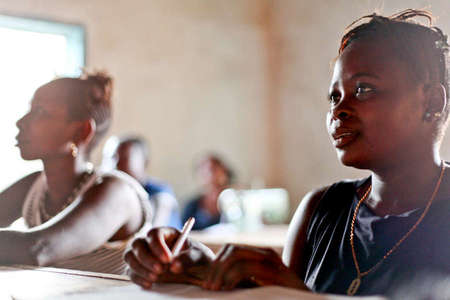 Young women make up for a missed education in an adult literacy class in Kamakwie, Sierra Leone (2011)