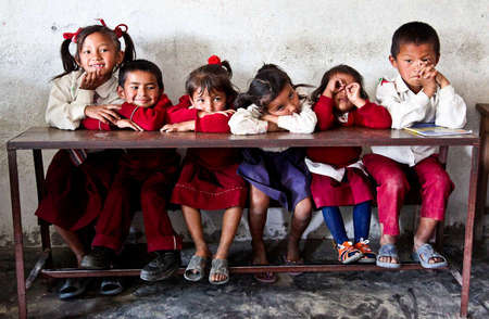 Children sit waiting for their teacher in Lahachowk at the Kent College Nepal Primary School. (2012)