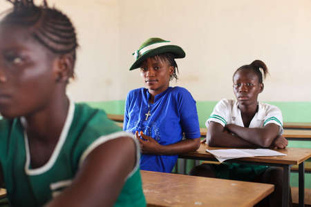 Rabiatu in her classroom in Makeni, Sierra Leone. Her education is funded by the Craig Bellamy Foundation